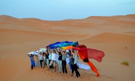 Students in desert with flags