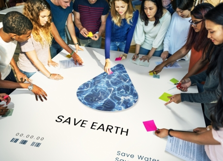 Sustainability Students with Save Earth table